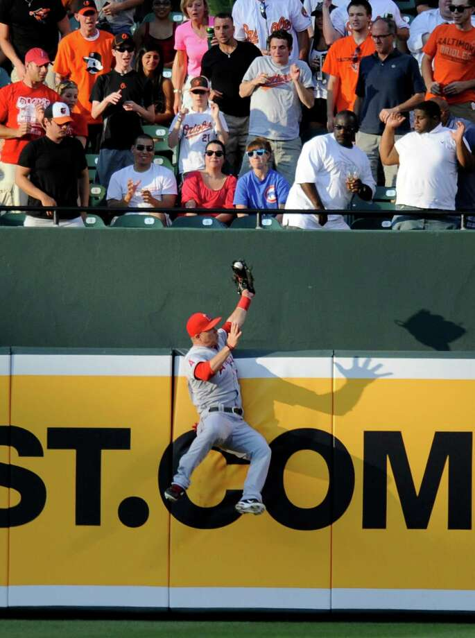 Los Angeles Angels center fielder Mike Trout catches a fly ball by Baltimore Orioles' J.J. Hardy during the first inning of a baseball game on Wednesday, June 27, 2012, in Baltimore. (AP Photo/Nick Wass) Photo: Nick Wass