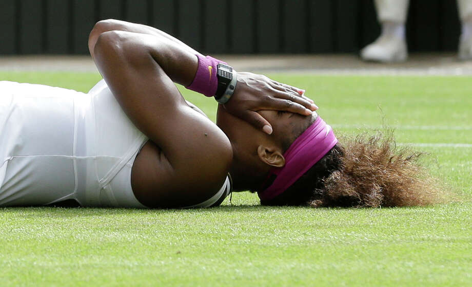 Serena Williams of the United States reacts after defeating Agnieszka Radwanska of Poland to win the women's final match at the All England Lawn Tennis Championships at Wimbledon, England, Saturday, July 7, 2012. (AP Photo/Kirsty Wigglesworth) Photo: Kirsty Wigglesworth