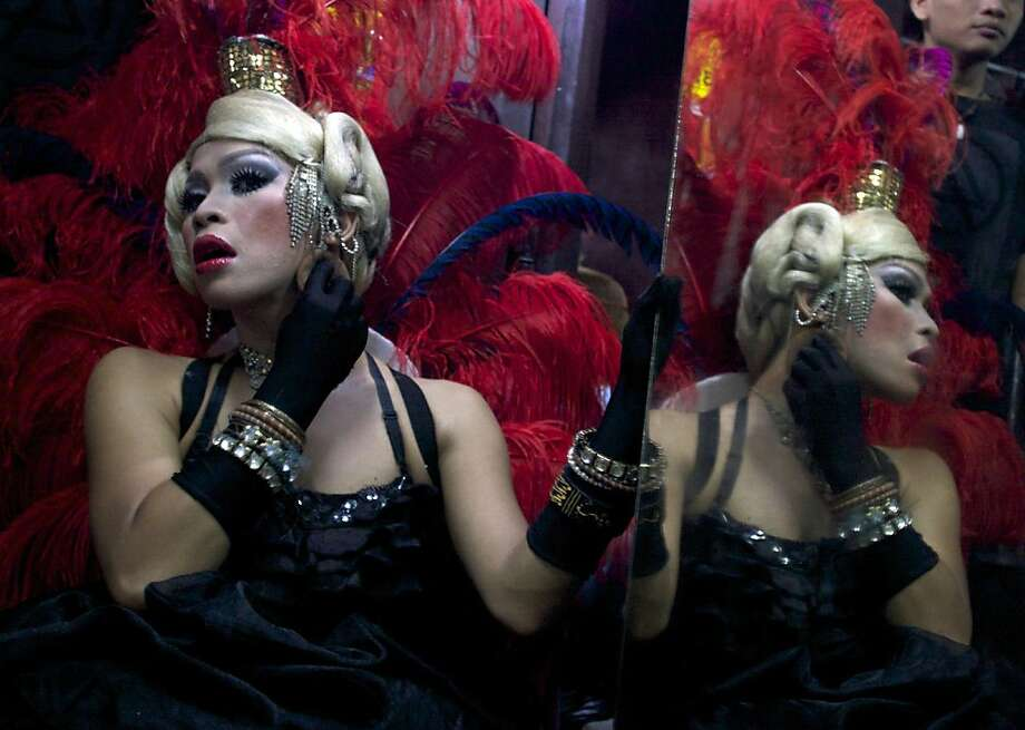 In this late Saturday, July 7, 2012 photo, an Indonesian transvestite applies make up as she prepares before performing in a cabaret show in Yogyakarta, Central Java, Indonesia. (AP Photo/Gembong Nusantara) Photo: Gembong Nusantara, Associated Press