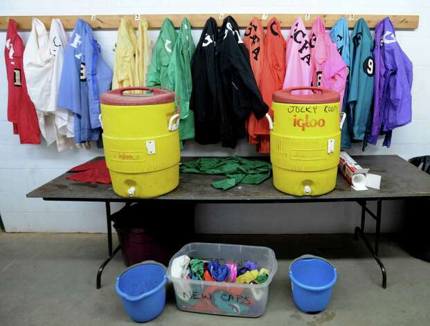 Jockey silks and refreshment in the locker room at the Gillespie County Fairgrounds in Fredericksburg on Saturday, July 7, 2012. Photo: Billy Calzada, San Antonio Express-News / © 2012 San Antonio Express-News