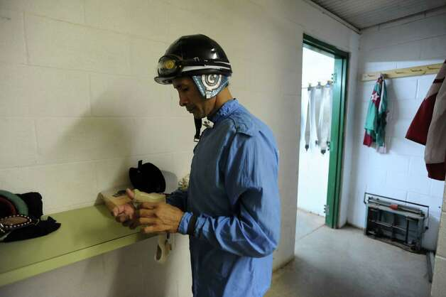 Isaac Chapa, who has been a jockey for 30 years, prepares for a race at the Gillespie County Fairgrounds in Fredericksburg on Saturday, July 7, 2012. Photo: Billy Calzada, San Antonio Express-News / © 2012 San Antonio Express-News