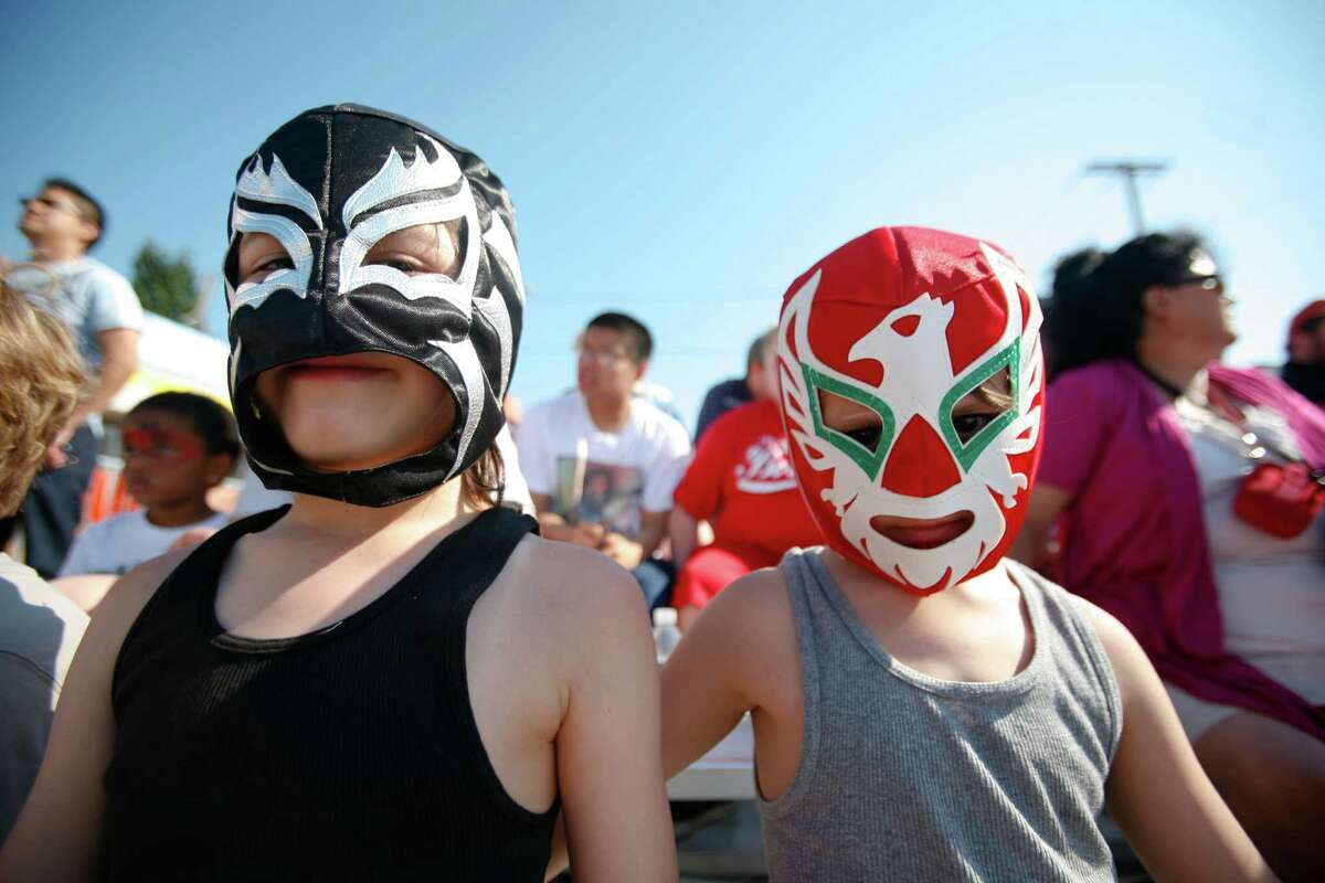 Daniel and Arturo Estrada are shown wearing traditional mexican Lucha Libre masks.