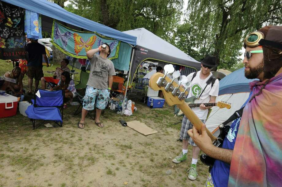 Phish fans Glue Lantigua, right, and Gypsy Joe Hocking perform music for other campers and Phish fans at Lee's Park campground in Saratoga Springs N.Y. Saturday July 7, 2012. (Michael P. Farrell/Times Union) Photo: Michael P. Farrell