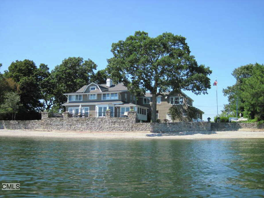 Halstead Darien offers a waterfront home for sale on Canfield Island in Norwalk, Conn. Photo: Contributed Photo