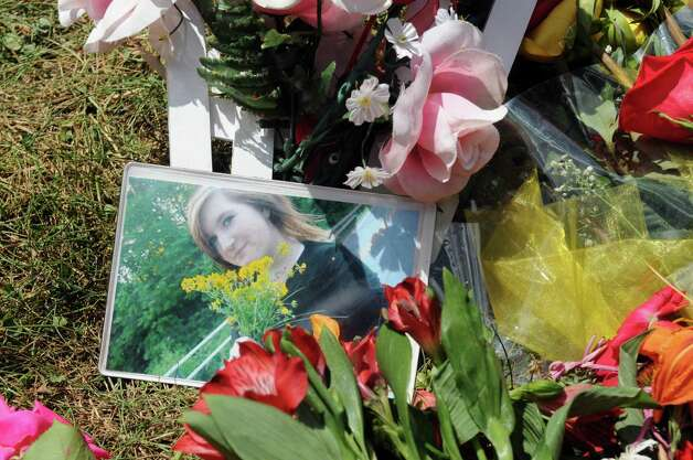 A picture of Kari Liedel at her roadside memorial. Liedel, 14, was killed Saturday night when she was struck by a car. The driver faces DWI charges. (Paul Buckowski/Times Union)