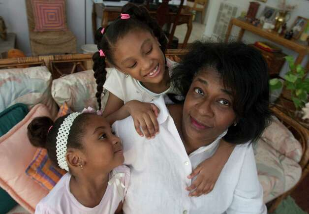 Bettina Cox is photographed with her granddaughters Akira, 4, (left) and Ariana, 6, Jackson at her home on Tuesday, July 6, 2012 in Richmond, Texas. She lost her health insurance several years ago when she lost her job.  Since then, she's developed serious health problems and is an example of someone who could benefit from the Medicaid expansion. Photo: J. Patric Schneider, For The Chronicle / Houston Chronicle