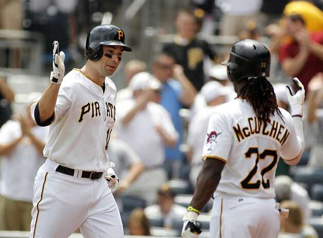 PITTSBURGH, PA - JULY 8:  Neil Walker #18 of the Pittsburgh Pirates celebrates after hitting a home run the third inning against the San Francisco Giants during the game on July 8, 2012 at PNC Park in Pittsburgh, Pennsylvania.  (Photo by Justin K. Aller/Getty Images) Photo: Justin K. Aller, Getty Images