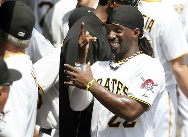 PITTSBURGH, PA - JULY 8:  Andrew McCutchen #22 of the Pittsburgh Pirates pokes fun in the dugout against the San Francisco Giants during the game on July 8, 2012 at PNC Park in Pittsburgh, Pennsylvania.  (Photo by Justin K. Aller/Getty Images) Photo: Justin K. Aller, Getty Images