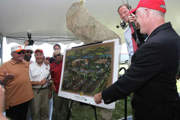 Mayor Bill Finch, right, unveils the Bass Pro Shops plan as the first tenant in the Steel Point redevelopment at a kick off  event in Bridgeport on Sunday, July 8, 2012. Photo: B.K. Angeletti / Connecticut Post freelance B.K. Angeletti