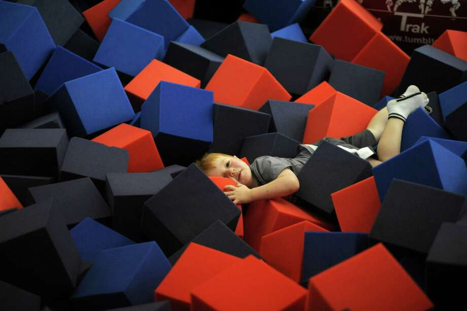 Drew Samaan, son of Chelsea Piers Connecticut Executive Director Mollie Marcoux, plays in one of the deep foam training pits in the gymnastics center at the facility. Photo: Cathy Zuraw / Stamford Advocate
