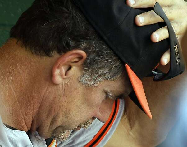 San Francisco Giants manager Bruce Bochy sits in the dugout during the seventh inning of a baseball game against the Pittsburgh Pirates in Pittsburgh, Sunday, July 8, 2012. The Pirates won 13-2. (AP Photo/Gene J. Puskar) Photo: Gene J. Puskar, Associated Press