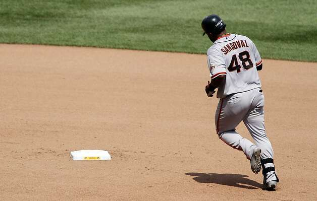 PITTSBURGH, PA - JULY 8: Pablo Sandoval #48 of the San Francisco Giants rounds second after hitting a two run home run in the seventh inning against the Pittsburgh Pirates during the game on July 8, 2012 at PNC Park in Pittsburgh, Pennsylvania. The Pirates defeated the Giants 13-2. (Photo by Justin K. Aller/Getty Images) Photo: Justin K. Aller, Getty Images