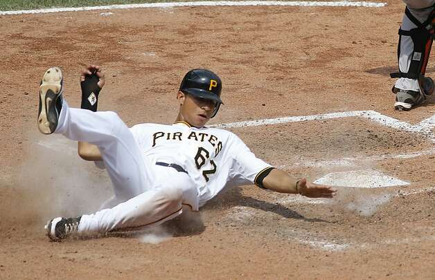 PITTSBURGH, PA - JULY 8: Gorkys Hernandez #62 of the Pittsburgh Pirates scores in the sixth inning on a throw error by the San Francisco Giants during the game on July 8, 2012 at PNC Park in Pittsburgh, Pennsylvania. The Pirates defeated the Giants 13-2. (Photo by Justin K. Aller/Getty Images) Photo: Justin K. Aller, Getty Images