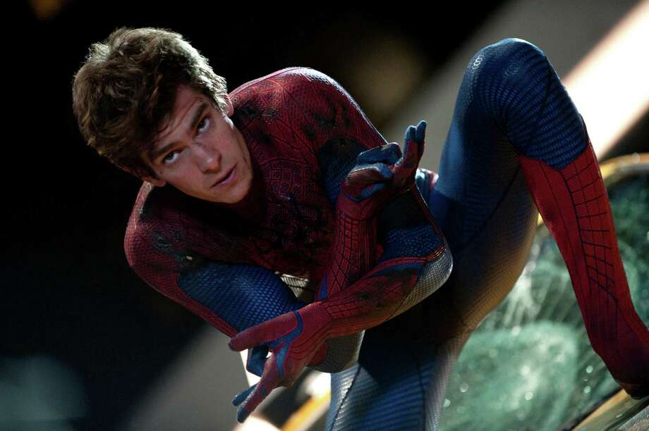 """In this film image released by Sony Pictures,  Andrew Garfield is shown in a scene from """"The Amazing Spider-Man, set for release on July 3, 2012. """"The Amazing Spider-Man"""" pulled in $7.5 million from its debut screenings just after midnight Tuesday, July 3. (AP Photo/Columbia - Sony Pictures, Jaimie Trueblood) Photo: Jaimie Trueblood"""