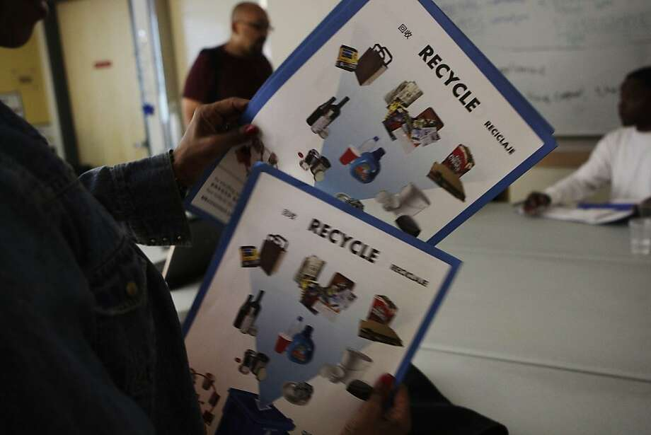 Yolandra McLoyd of San Francisco organizes a stack of leaflets to hand out as part of her outreach after the   Community Housing Partnership's Recycling and Environmental Awareness Program on Wednesday, June 20, 2012 in San Francisco, Calif. The Recycling and Environmental Awareness Program is a 10 week program in which participants meet once a week in addition to 4 hours of outreach each week on their own. Photo: Lea Suzuki, The Chronicle