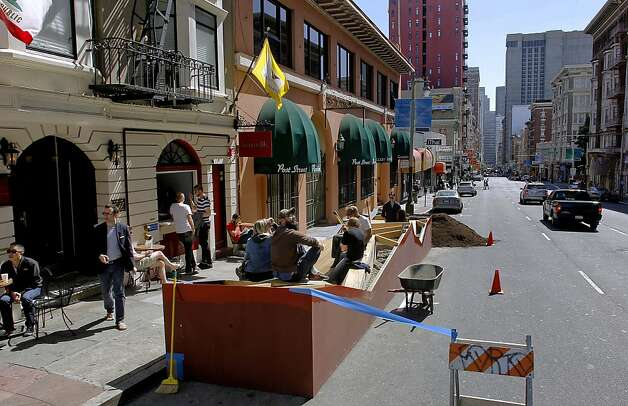 People enjoy the new space, as neighbors, friends and volunteers, prepare to put the finishing touches on the newly installed parklet in front of Farm: Table Restaurant on Post St. near Jones, on Saturday July 7, 2012, in San Francisco, Calif. Farm:Table Restaurant, used kickstarter to raise money to construct a parklet and install it on the street in front of the business. Photo: Michael Macor, The Chronicle