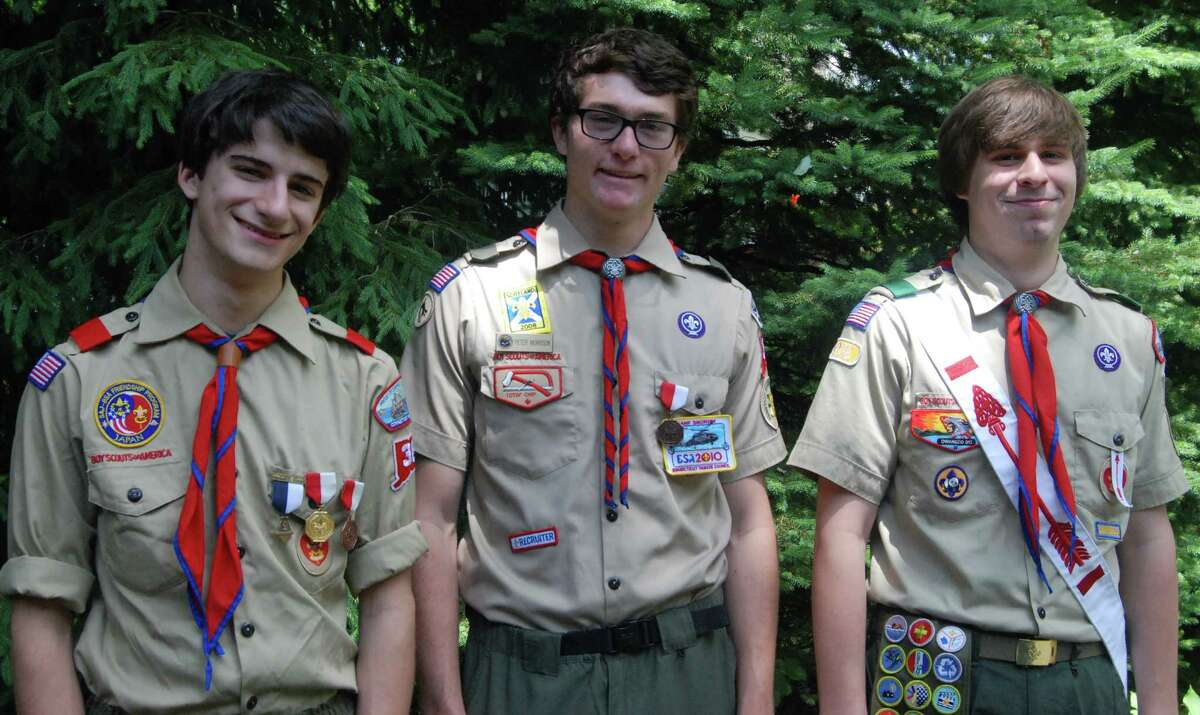 Awarded Eagle Scout badges by Troop 36 during recent ceremonies were, from left Andrew Allison-Godfrey, Peter Morrison and Devon Gillespie.