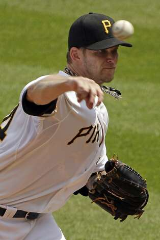 Pittsburgh Pirates pitcher A.J. Burnett delivers during the sixth inning of a baseball game against the San Francisco Giants in Pittsburgh Sunday, July 8, 2012. The Pirates won 13-1, with Burnett getting his 10th win. (AP Photo/Gene J. Puskar) Photo: Gene J. Puskar, Associated Press