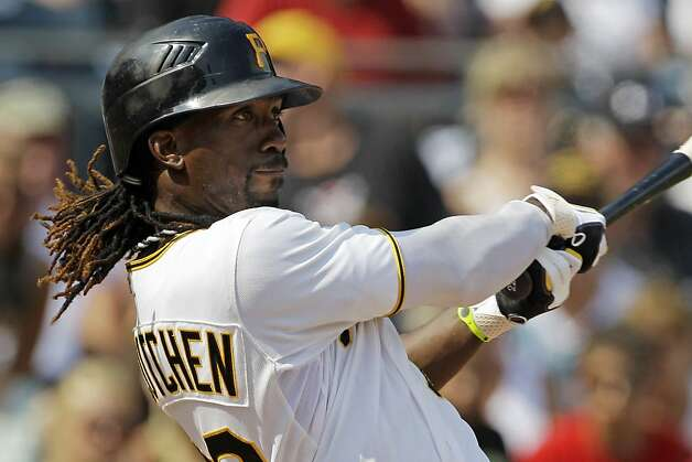 Pittsburgh Pirates' Andrew McCutchen watches his second two-run home run of the game leave the park during the seventh inning of a baseball game against the San Francisco Giants in Pittsburgh Sunday, July 8, 2012. The Pirates won 13-2. (AP Photo/Gene J. Puskar) Photo: Gene J. Puskar, Associated Press