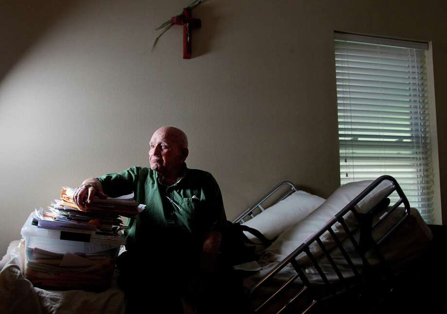 World War II veteran William Maxson, 94, has a stack of photocopied VA claim forms submitted over the years. Maxson has waited seven years for the VA to make a decision on his benefits. Photo: Mayra Beltran / © 2012 Houston Chronicle