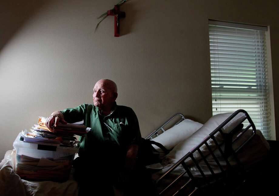 "World War II veteran William Maxson, 94, sits next to a stack of photocopied Veteran Affairs claim forms submitted over the years on Friday, July 6, 2012, in Houston. Maxson has waited seven years for the Department of Veterans Affairs to make a final decision about his benefits has once again found himself in VA's record claims backlog. VA officials declined to add his nursing home in Tomball to a list of approved facilities. He moved in with his son and asked VA to increase his monthly compensation for ""aid and attendance,"" a pension available to wartime veterans who have in-home care. VA told Maxson his case would be expedited because of his advanced age, but almost a year passed and he is still waiting. He and his family worry that he will die before VA acts on his claim. Maxson's situation highlights the plight of elderly veterans, who are running out of time for VA to process their claims. Photo: Mayra Beltran, Houston Chronicle / © 2012 Houston Chronicle"