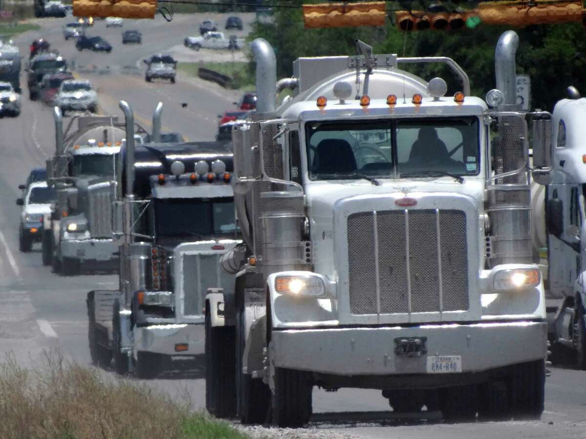 Trucks involved in the Eagle Ford Shale energy industry make their way along Highway 181 in Kenedy last Friday.