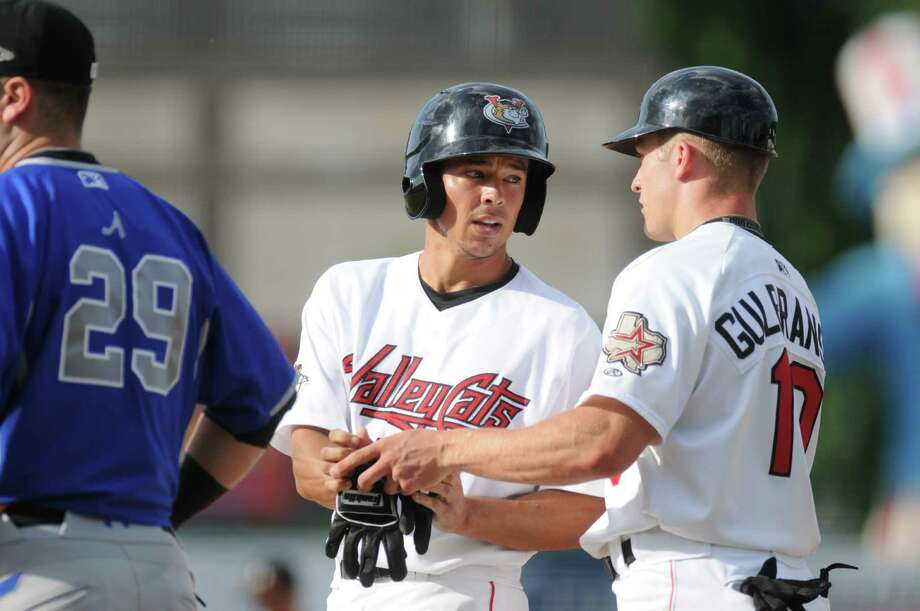 Tri-City ValleyCats shortstop Joe Sclafani, center, talks with first base coach Dan Gulbransen, right, after driving in his team's second run in the bottom of the second during their game against the Aberdeen IronBirds at Joseph Bruno Stadium on Sunday evening July 8, 2012 in Troy, NY. (Philip Kamrass / Times Union) Photo: Philip Kamrass / 00018017I