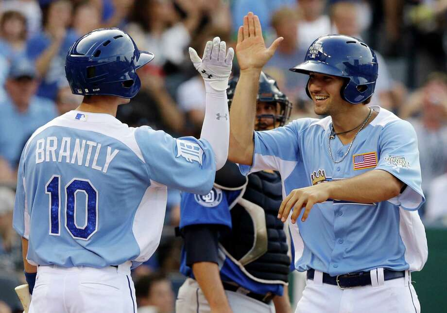 United States Nick Castellanos, right, celebrates his three-run home run with Rob Brantly during the sixth inning of the MLB All-Star Futures baseball game against the World, Sunday, July 8, 2012, in Kansas City, Mo. (AP Photo/Charlie Riedel) Photo: Charlie Riedel