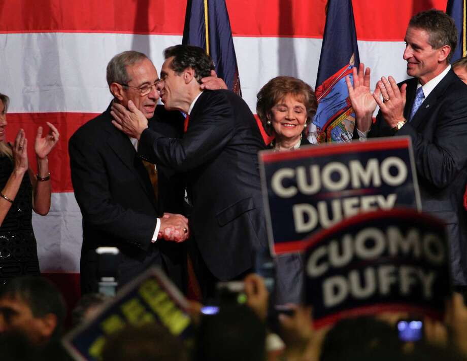 """FILE -- Andrew Cuomo kisses his father, former Gov. Mario Cuomo, during his victory speech after being elected governor of New York in New York City, Nov. 2, 2010. Cuomo has said he wants to concentrate on being 'the best governor I can be,"""" but his father has mused about presidential ambitions for his son. (Richard Perry/The New York Times) Photo: RICHARD PERRY / NYTNS"""