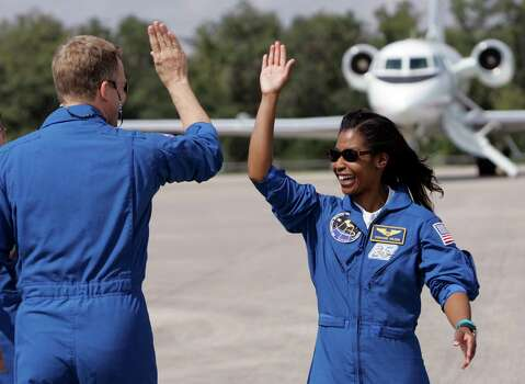 Stephanie D. Wilson: Astronaut, mission specialist on Space Shuttle mission STS-121 and second black woman to go into space. At left is Space Shuttle Discovery mission specialist Scott Parazynski. Photo: John Raoux, Associated Press / AP