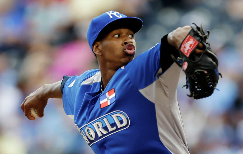 World starting pitcher Yordano Ventura delivers during the first inning of the MLB All-Star Futures baseball game against United States, Sunday, July 8, 2012, in Kansas City, Mo. (AP Photo/Jeff Roberson) Photo: Jeff Roberson
