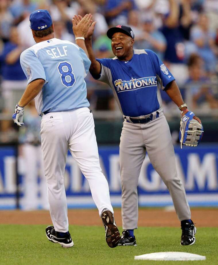 Kansas men's basketball head coach Bill Self (8) is congratulated by Hall of Famer Ozzie Smith during the MLB All-Star celebrity softball game, Sunday, July 8, 2012, in Kansas City, Mo. (AP Photo/Charlie Riedel) Photo: Charlie Riedel
