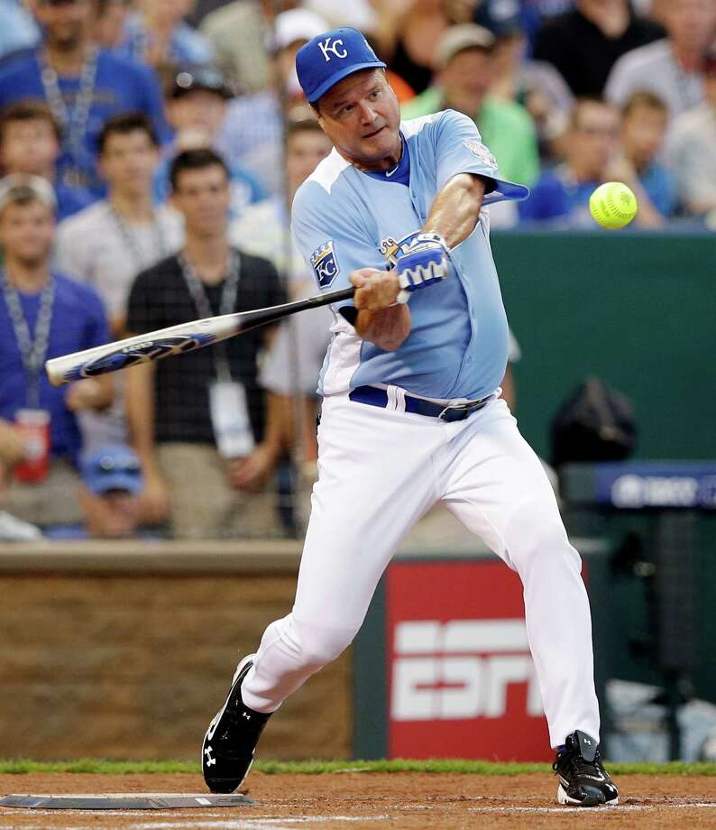 Kansas men's basketball head coach Bill Self hits a home run during the MLB All-Star celebrity softball game, Sunday, July 8, 2012, in Kansas City, Mo. (AP Photo/Charlie Riedel) Photo: Charlie Riedel