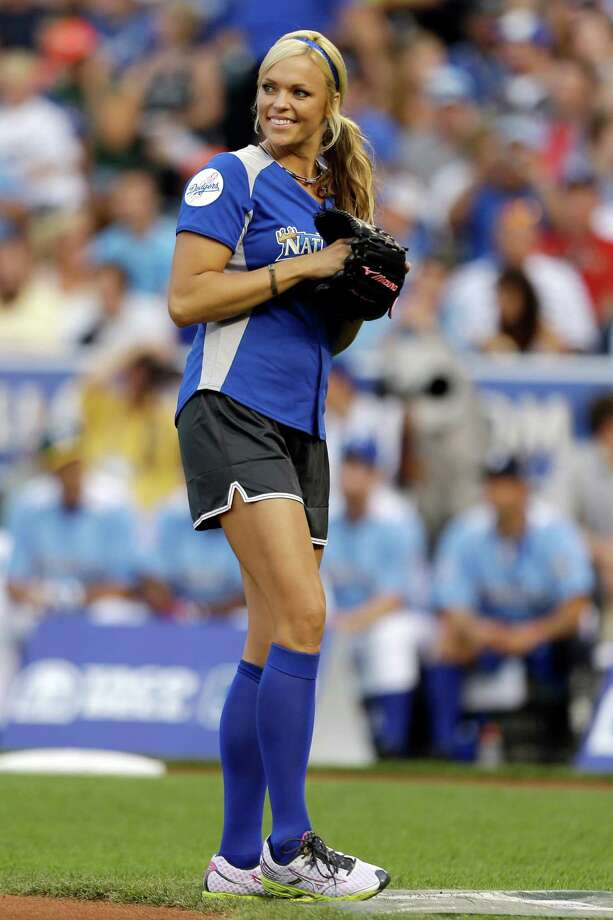 Former softball player Jennie Finch prepares to pitch during the first inning of the MLB All-Star celebrity softball game, Sunday, July 8, 2012, in Kansas City, Mo. (AP Photo/Jeff Roberson) Photo: Jeff Roberson