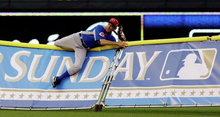 Actor James Denton tries to make a diving catch during the MLB All-Star celebrity softball game, Sunday, July 8, 2012, in Kansas City, Mo. (AP Photo/Charlie Riedel) Photo: Charlie Riedel