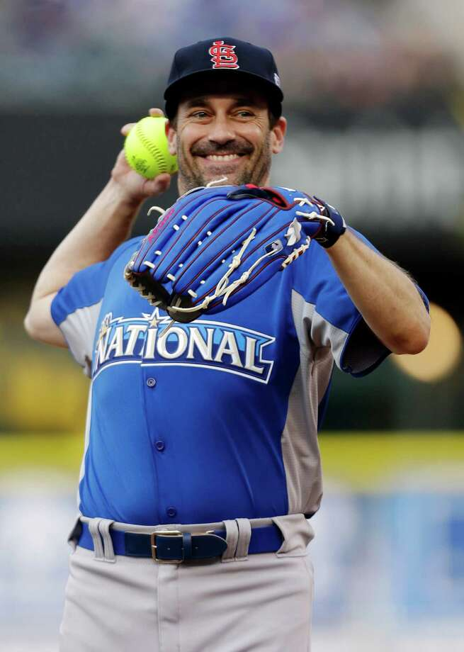 Actor Jon Hamm warms up before the MLB All-Star celebrity softball game, Sunday, July 8, 2012, in Kansas City, Mo. (AP Photo/Jeff Roberson) Photo: Jeff Roberson