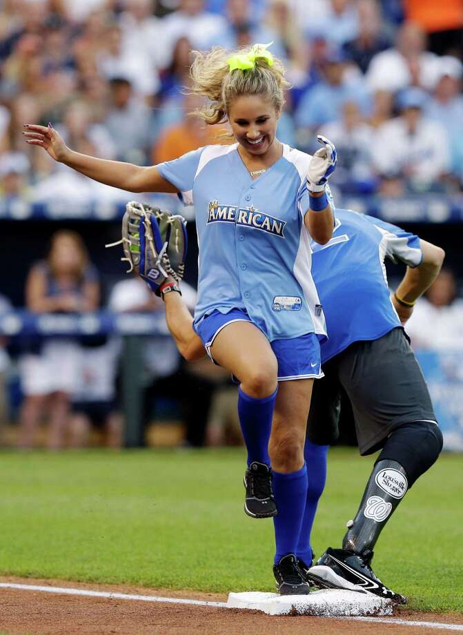 Singer Haley Reinhart is forced out at first base during the first inning of the MLB All-Star celebrity softball game, Sunday, July 8, 2012, in Kansas City, Mo. (AP Photo/Charlie Riedel) Photo: Charlie Riedel