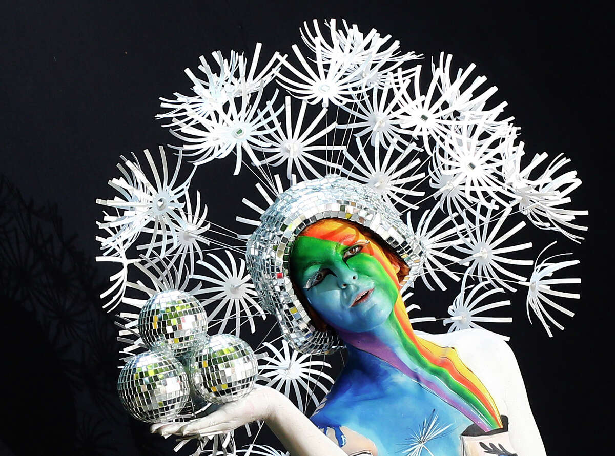 A participant poses with her body paintings during the 15th World Bodypainting Festival in Poertschach, Austria.