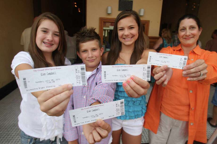 Jenny Shaw, right, daughter Sara, 13, Eddy, 11, and their cousin Kalyn Glass, 13, show off their tickets to the show.  Photo: J. Patric Schneider, For The Chronicle / Houston Chronicle