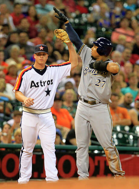 Milwaukee Brewers Carlos Gomez, left, gestures after on a sharp fly ball to center field as Houston Astros third baseman Matt Dominguez, left, holds up his glove during the seventh inning of a Major League Baseball game at Minute Maid Park Friday, July 6, 2012, in Houston. (Cody Duty / Houston Chronicle) Photo: Cody Duty / © 2011 Houston Chronicle