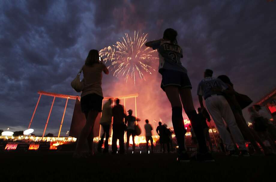 Players watch the fireworks after the MLB All-Star celebrity softball game, Sunday, July 8, 2012, in Kansas City, Mo. (AP Photo/Charlie Riedel) Photo: Charlie Riedel, Associated Press