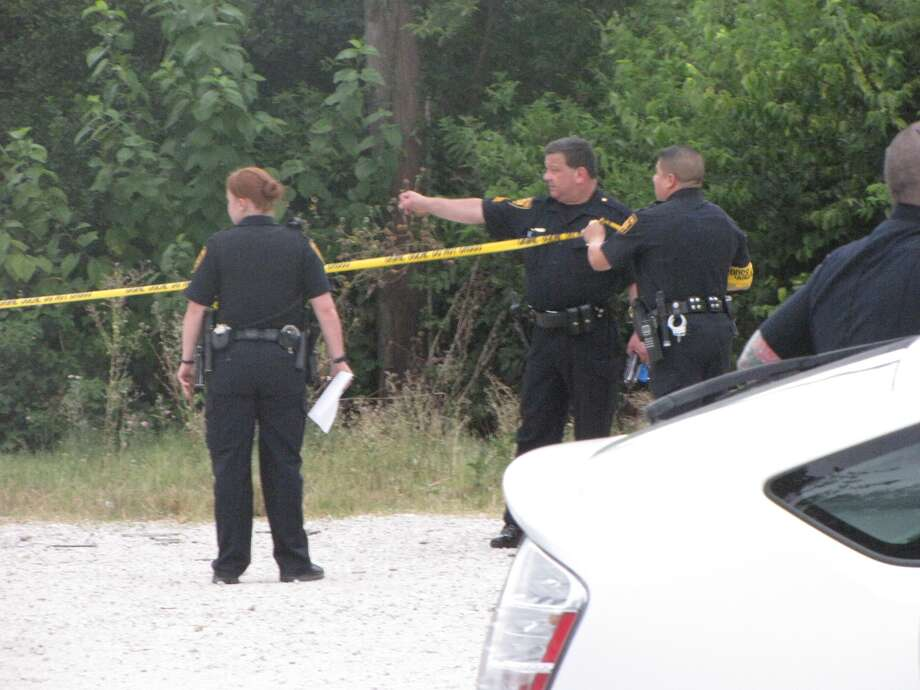 San Antonio police investigate the scene where a woman's nude body was apparently dumped several days ago. Neighbors reported a strong odor Sunday evening, when police found the woman's decomposing body. Photo: Eva Ruth Moravec/emoravec@express-news.net