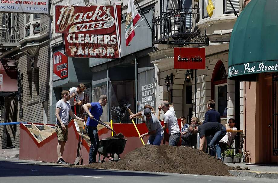 A community effort, as neighbors, friends and volunteers, help to put the finishing touches on the newly installed parklet in front of Farm: Table Restaurant on Post St. near Jones, on Saturday July 7, 2012, in San Francisco, Calif. Farm:Table Restaurant, used kickstarter to raise money to construct a parklet on the street in front of the business. Photo: Michael Macor, The Chronicle