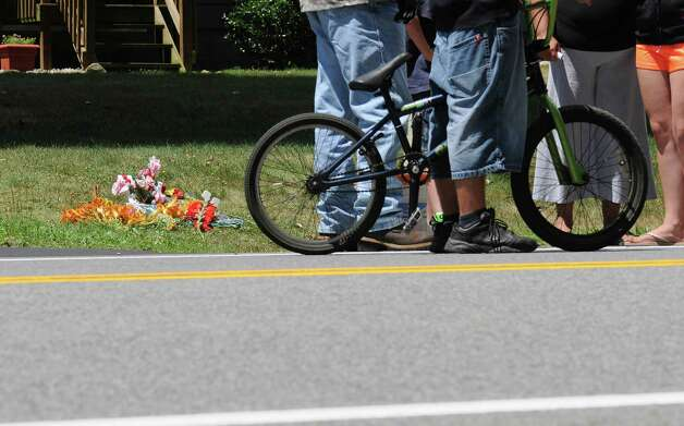 Family and friends gather on Sunday, July 8, 2012, at the scene on West Milton Road where  14-year-old Kari Liedel was killed Saturday.  A small memorial with flowers and crosses was set up near the spot where she was struck.  (Paul Buckowski / Times Union) Photo: Paul Buckowski