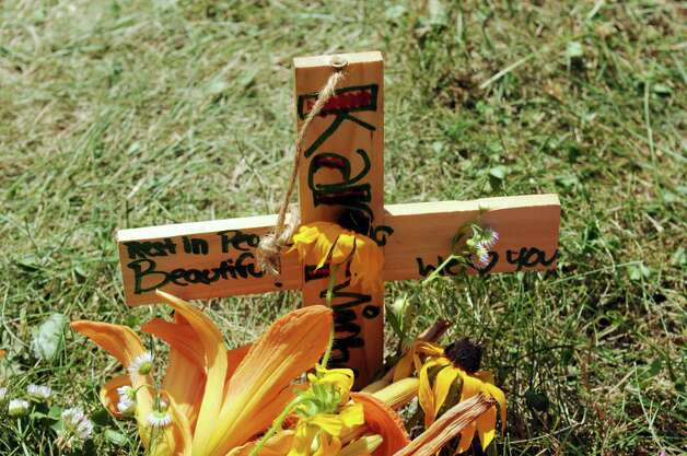 A cross is seen at a memorial set up on Sunday, July 8, 2012, at the scene on West Milton Road where  14-year-old Kari Liedel was killed Saturday.  (Paul Buckowski / Times Union) Photo: Paul Buckowski