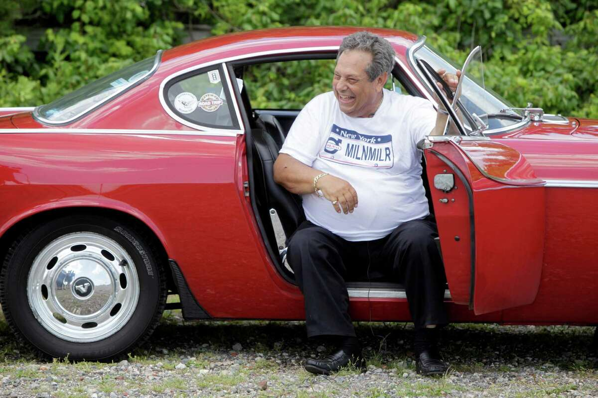 Irv Gordon laughs while being interviewed in his Volvo P1800 in Babylon, N.Y., Monday, July 2, 2012. Gordon's car already holds the world record for the highest recorded milage on a car and he is less than 40,000 miles away from passing three million miles on the Volvo. (AP Photo/Seth Wenig)