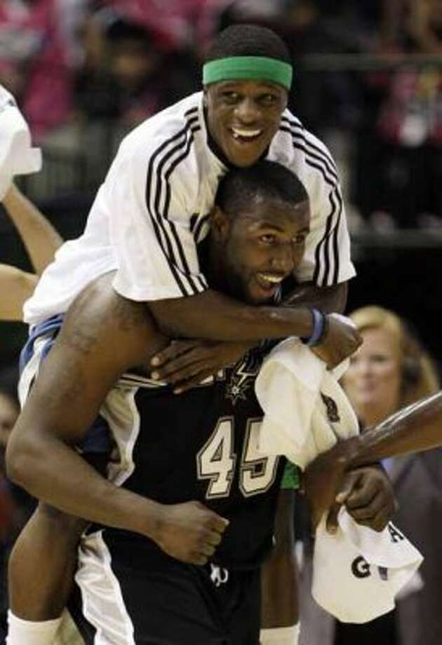 Minnesota Timberwolves Jonny Flynn celebrates with San Antonio Spurs' DeJuan Blair (45) after the rookies beat the Sophomores 140-128 in the Rookie Challenge game during the NBA basketball All-Star Weekend Friday, Feb. 12, 2010, in Dallas. (AP Photo/LM Otero) (AP)