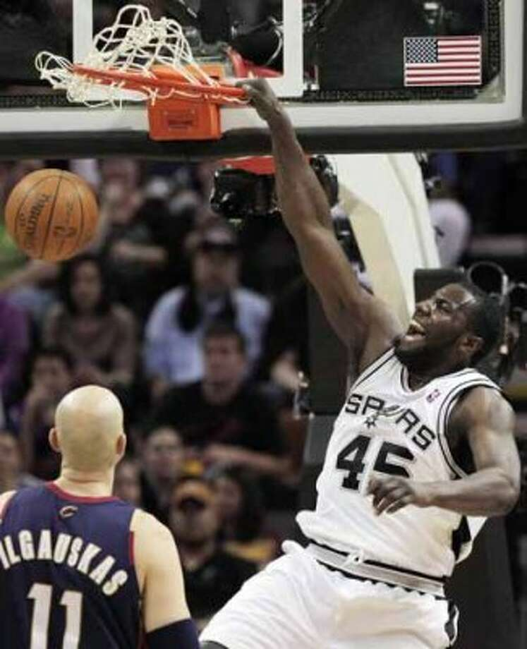 San Antonio Spurs' DeJuan Blair, right, dunks over Cleveland Cavaliers' Zydrunas Ilgauskas, of Lithuania, during the second half of an NBA basketball game in San Antonio, Friday, March 26, 2010. San Antonio won 102-97. (AP Photo/Darren Abate) (AP)