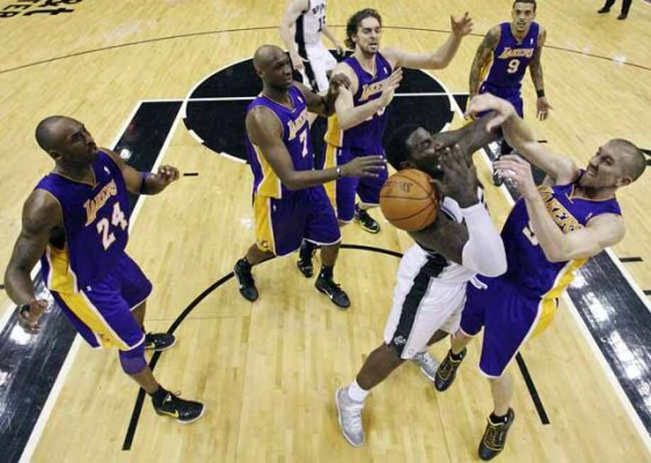 FOR SPORTS - Spurs' DeJuan Blair and Lakers' Steve Blake grab for a rebound during second half action Tuesday Dec. 28, 2010 at the AT&T Center. The Spurs won 97-82. (PHOTO BY EDWARD A. ORNELAS/eaornelas@express-news.net) (SAN ANTONIO EXPRESS-NEWS)