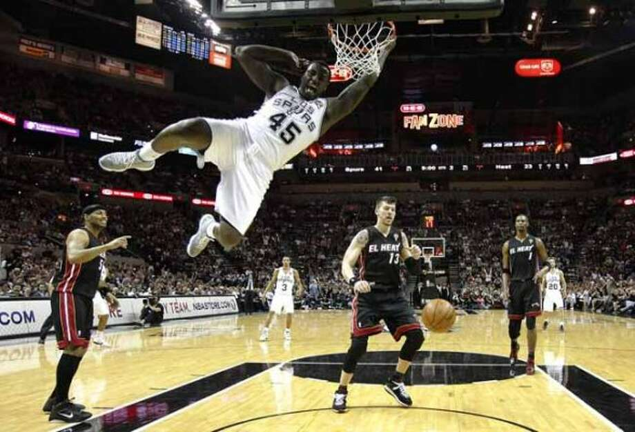 Spurs' DeJuan Blair (45) slams home two-points against the Miami Heat at the AT&T Center on Friday, Mar. 4, 2011. Spurs defeated the Heat, 125-95. Kin Man Hui/kmhui@express-news.net (SAN ANTONIO EXPRESS-NEWS)